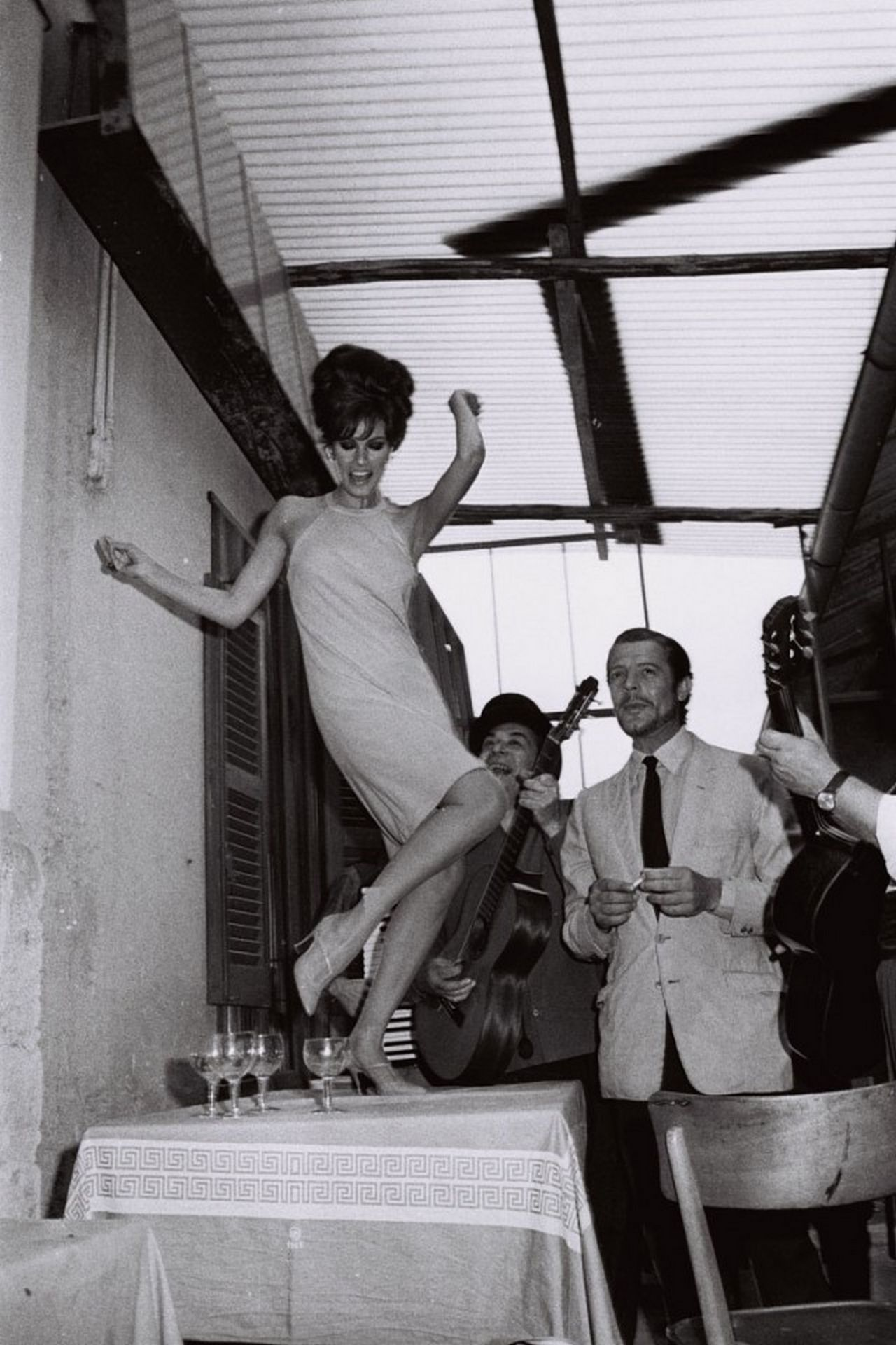 Raquel Welch and Marcello Mastroianni at Rome's Cinecittà studios on the set of the film Shoot Loud, Louder I Do Not Understand in 1966.